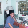 Head Start Children Centre Manager Warren Meekis  using      his office IP phone.
