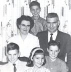 Peggy Sanders and her family- Front row, left to right, Peter, Christine, Kenny. Middle row: Peggy, her husband Don. Back row: J
