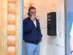 Paul testing the single toll phone in the community (probably phoning Bell to tell them that they can easily add more lines to t