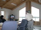 Meeting with John Moreau via video in the Slate Falls Band office board room