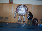 Thats Allison Kakepetum sweeping up the floor by the Keewaywin Logo.