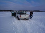 There was blowing snow the night before which covered most of the winter road on the ice.l