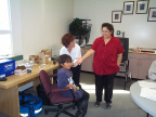 Brenda Pascal, Keewaywin's teacher assistant is there to help with the nurse give flu shots for her students.