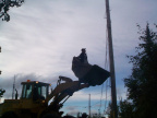 Martin Kakegamic going to the pole, to cut the wires from hydro poles to the building.
