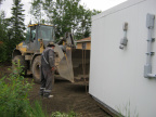 2012-06-20-19-moving-NSL-Cable-Headend-Building-into-place-by-band-office