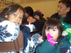 Everyone enjoys the community feast in Poplar Hill - January 23, 2002