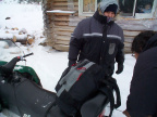 Peter Morriseau tying up here pack sack to the back of the skidoo. Alot of preparations is needed before you go on a long skidoo
