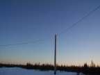 Hydro lines and hydro poles in Koocheching community.
