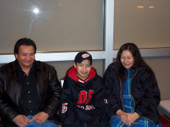 Reynold with his mom and dad at the airport in Thunder Bay on his way home