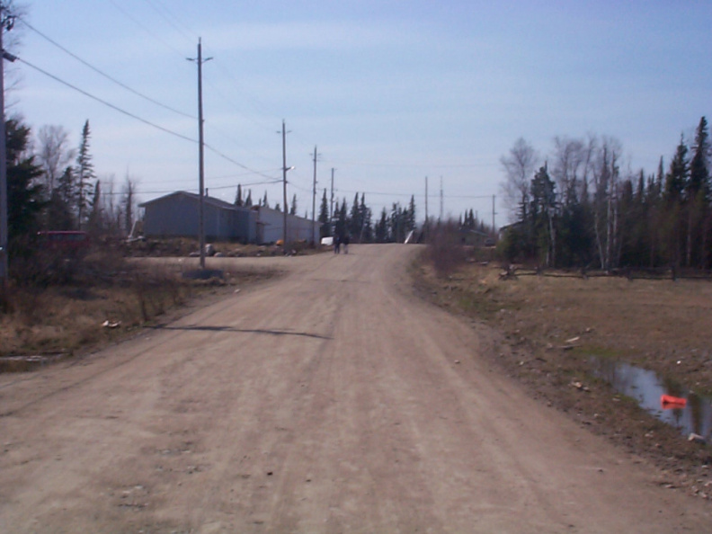 A picture taken of the road that leads to the Chief's house on the left side, with KiHS on the left, but not in the picture.
