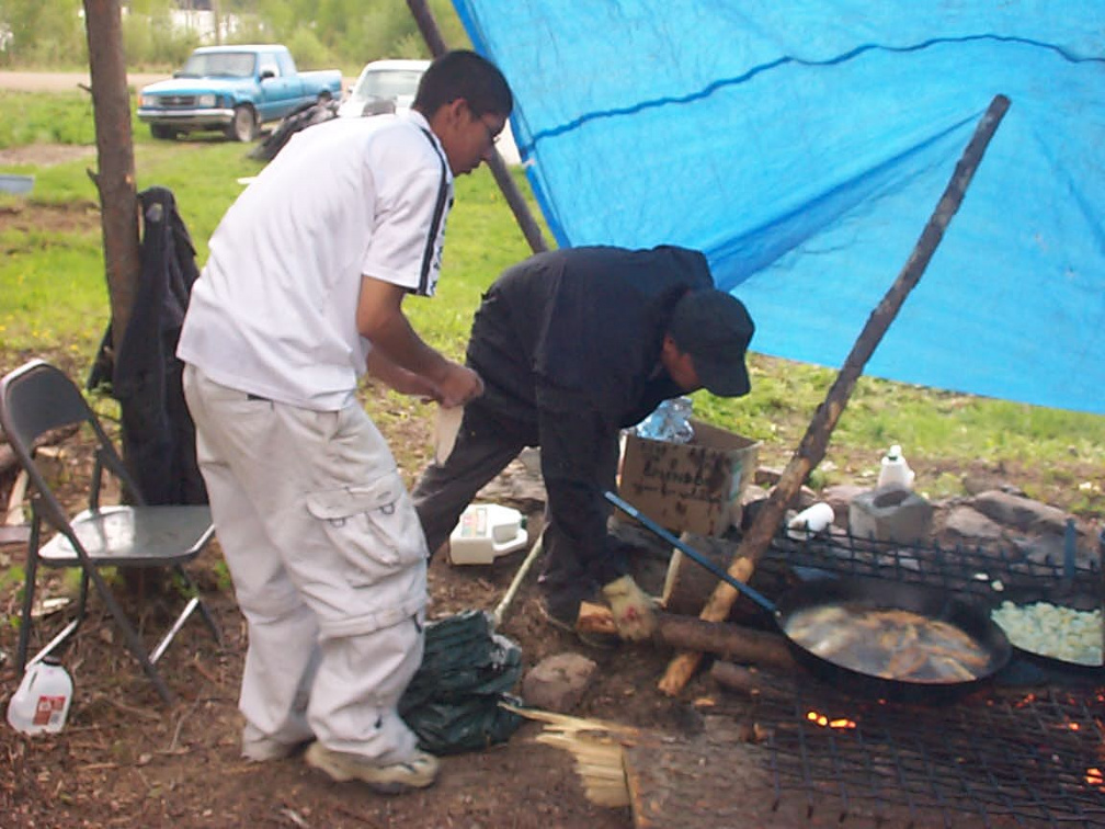 Wayne and Davie cooking fish