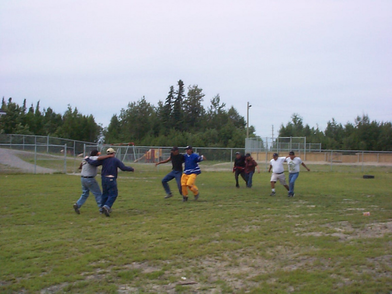 The men coming to the home stretch,3legged race.