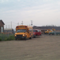The school bus sits close by the airport, with the medical van right behind it.