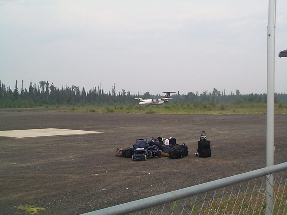 Here is the plane on the runway, with the luggage on that will be ready to be loaded.