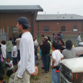 A picture of the community members watching the plane.