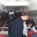 Here Deboarh Rae, helps Nancy Linklater, with the stewardess standing by to assist if necessary.