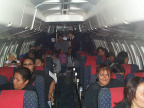 A picture taken from the front of the plane as they were all seated.