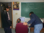 Ferdi Vanzyl (KiHS Teacher)assists a student while James Rae (assistant) are helping looks on.