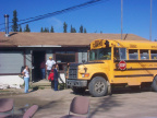 Students of David Meekis Memorial School arrive by the school bus