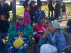 Local elders wait in the shade for the ceremony to begin.