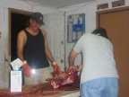 here is carol cutting up the meat and Andy looking on