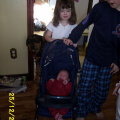 Matthew doesn't like Rebecca's doll stroller.