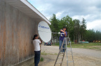 Barb and Cal working on the two way satellite!