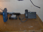 Ka satellite modem (left) wireless router equipment and Cisco IP telephone