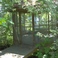 The screened-in gazebo on the other side of the stream