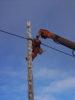 Roy attaching the wire to the pole.
