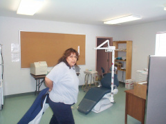 And here comes the dental assistant getting ready to work.