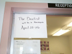 This sign has been on the window at the clinic for some time now explaining that a dentist is actually coming to Keewaywin.