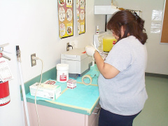 And here she is packing the sterilized equipment. Getting it all ready for use.