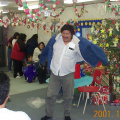 Johnny Meekis, Education Director, opens up his new jacket during the staff gift exchange.