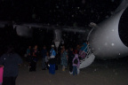The camera must be dirty. i see spots anyways here is another photo of people getting on the plane.