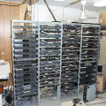 The cable headend equipment. The upconverter is in the left most rack at the very top. The other equipment are satellite receive