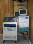 The satellite rack, uBR7223, cable registration server and DirecPC box (K-Net Router).