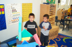 Garcia and Gavin playing with foam blocks.