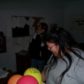 This is Mary Kakegamic getting balloons ready for the games. At the back is Karen Kakepetum.