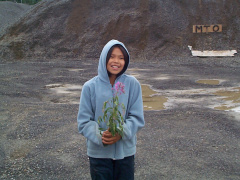 Here is Dancine Rae holding a Fire-Weed.