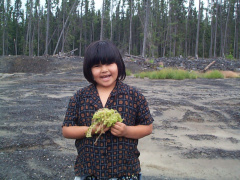Here is Cherille Keesic holding a Peat Moss plant.