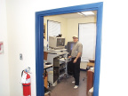 Technician from Toronto installing telehealth workstation at telehealth office in North Spirit.